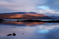 Ashaig Beach early morning view to Applecross Hills . Lower Breakish. Isle of Skye. Scotland.