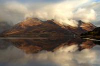 Five Sisters,  and Loch Duich,  cloudy reflection.  North West Highlands. Scotland.