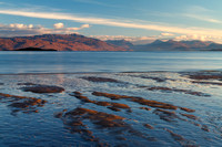 Ashaig Beach, early morning light, view to mainland . Lower Breakish. Isle of Skye. Scotland.