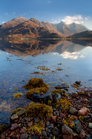 Five Sisters reflected in Loch Duich, from Ratagan village PF . North West Highlands. Scotland.
