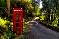 Carsaig. Road to the Pier and Telephone Box. Isle of Mull. Scotland.