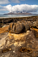 Eigg. Sandstone Concretions and the Isle of Rum. Highlands and Islands. Scotland.