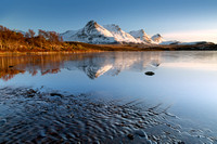 Ben Loyal across Lochan Hakel. Evening sun in Winter. Tongue. Sutherland. Scotland.