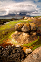 Isle of Eigg. Sandstone Concretions. Cloud over Rum. Small Isles. Scotland.