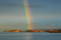 Coigach. Rainbow over Tanera Mor, An Teallach and the Hills of Fisherfield. Highland Scotland.