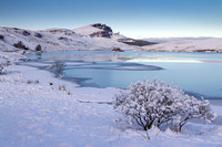 Old man of Storr  and Loch Fhada with snow. Trotternish. Isle of Skye. Scotland.