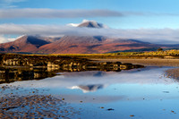 Ben Na Caillich reflected in tidal pool Ashaig Beach. Lower Breakish. Isle of Skye. Scotland.