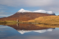 Ardvreck Castle and Quinag. Reflection in Loch Assynt. Highland Scotland.