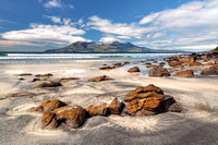 Isle of Eigg. A view of the Isle of Rum from Laig Beach. Highlands and Islands. Scotland.