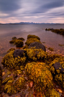 Badentarbet shoreline rocks. View to Wester Ross. Long Exposure. Coigach. North West Geopark. Scotland.