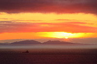 Neist Point Sunset. View over The Uists . Outer Isles. Isle of Skye. Scotland.