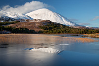 Beinn na Caillich reflected in a partially frozen Lochan Cill Chriosd. Strath Suardal. Isle of Skye. Scotland.